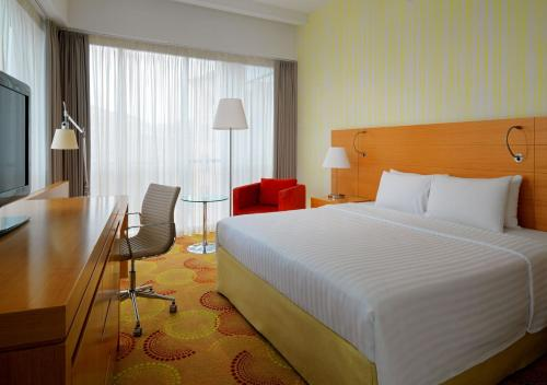 A bed or beds in a room at Courtyard by Marriott Budapest City Center