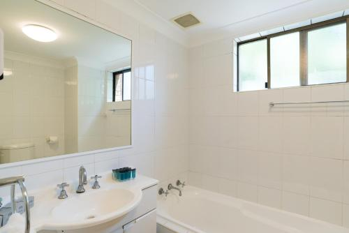 A bathroom at Eastwood Furnished Apartments