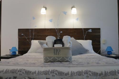 Letto o letti in una camera di BiancoCancello