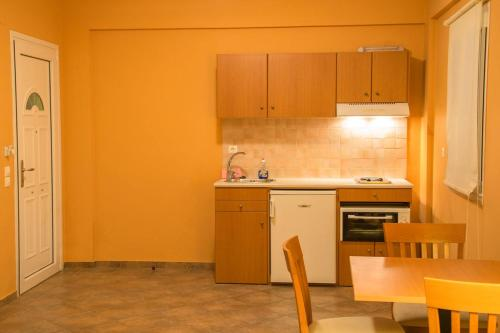 A kitchen or kitchenette at Saint Catherine Hotel
