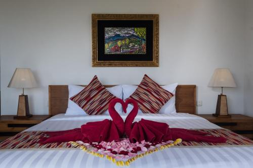 Tempat tidur dalam kamar di Puri Galih Villa