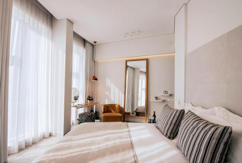 A bed or beds in a room at 65 Hotel, Rothschild Tel Aviv - an Atlas Boutique Hotel