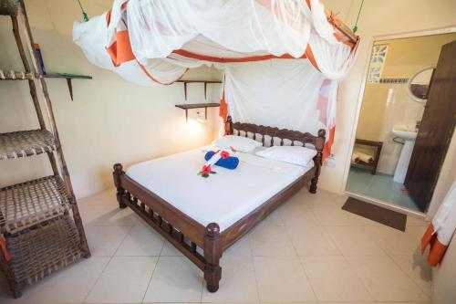 A bed or beds in a room at Ndame Beach Lodge