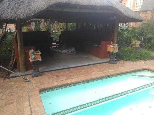 The swimming pool at or near Treetops & Treats Guest House