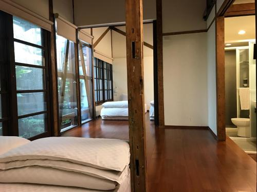 A bed or beds in a room at Hsin Kang 77villa