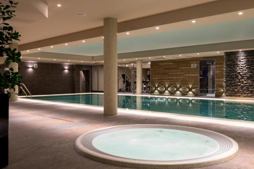 The swimming pool at or near AC Hotel by Marriott Wroclaw