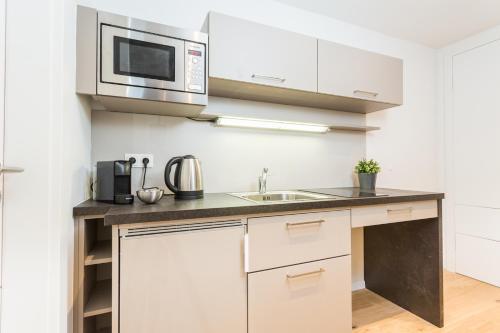 Küche/Küchenzeile in der Unterkunft Room 5 Apartments