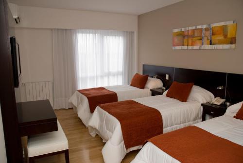 Кровать или кровати в номере Agua Dulce Hotel