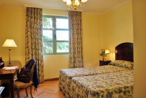 A bed or beds in a room at La Quinta de los Cedros