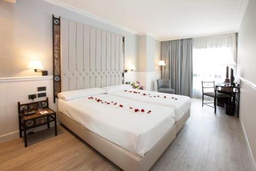 Uma cama ou camas num quarto em Hotel Gran Via