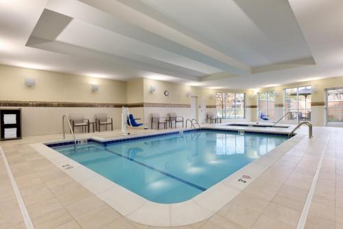 The swimming pool at or near Courtyard by Marriott Boston Dedham/Westwood