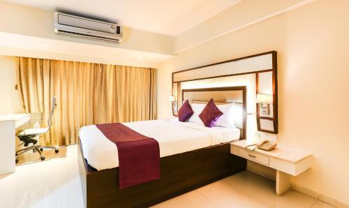 Treebo Tryst Metropolis Hyderabadにあるベッド