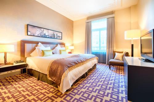 Cama o camas de una habitación en Alden Suite Hotel Splügenschloss Zurich