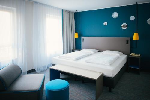 Ein Bett oder Betten in einem Zimmer der Unterkunft Vienna House Easy Bad Oeynhausen