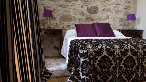 A bed or beds in a room at Casa Libélula - Serra da Estrela