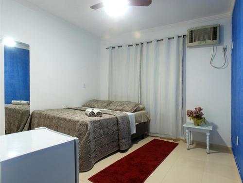 Cama ou camas em um quarto em Pousada Garoupa