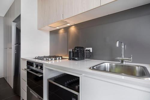 A kitchen or kitchenette at Astra Apartments Newcastle