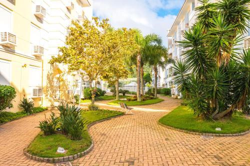 Jardín al aire libre en apto na Praia do Ingleses