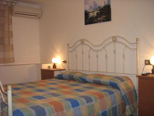 Letto o letti in una camera di Villa Violetta