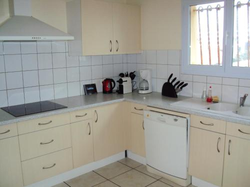 A kitchen or kitchenette at Les Terrasses