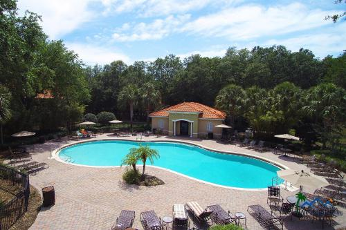 The swimming pool at or close to Four Bedroom TownHome w/ game room 5128