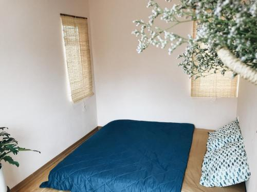 A bed or beds in a room at Dadia Home