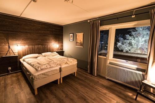Säng eller sängar i ett rum på Parkvillan