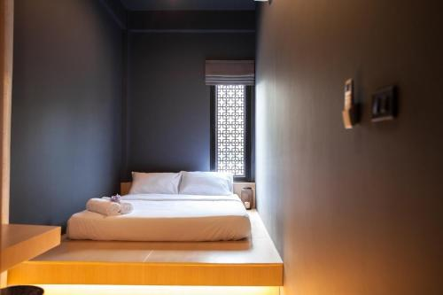 A bed or beds in a room at CLOUD on Saladaeng Silom Hostel Bangkok