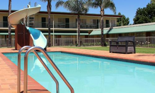 The swimming pool at or near Motel Riverina