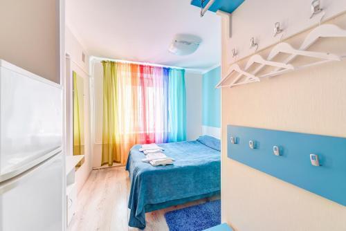 Кровать или кровати в номере Апарт Отель Радуга