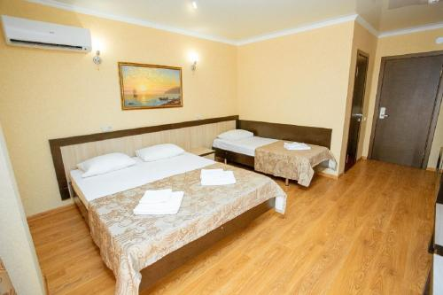 A bed or beds in a room at Hotel Venera 4
