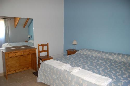 A bed or beds in a room at La Estancia