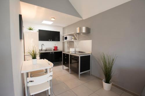 Een keuken of kitchenette bij Bungalow Serenity Maspalomas