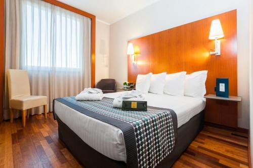 Letto o letti in una camera di Eurostars Toscana