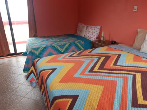 A bed or beds in a room at Paradise Villas