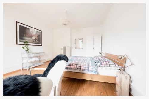 Ein Bett oder Betten in einem Zimmer der Unterkunft Bed & Kitchen am Tavelweg - Adults Only