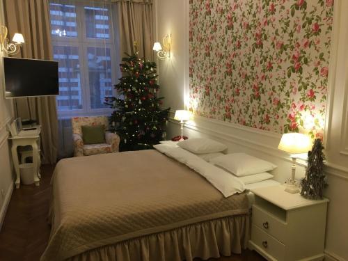 Łóżko lub łóżka w pokoju w obiekcie Blueberry Apartments