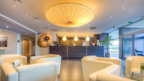 The lobby or reception area at Hotel & Aparthotel Horizon Ath Lessines