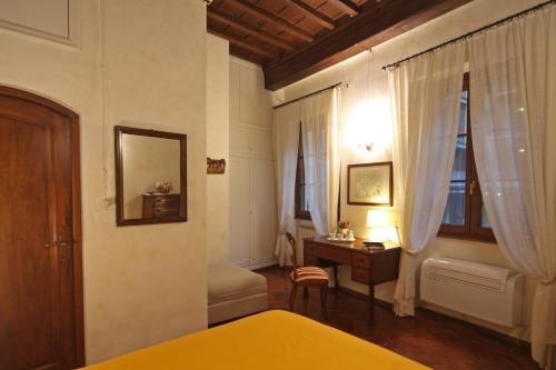 Cama o camas de una habitación en Verrazzano Apartment
