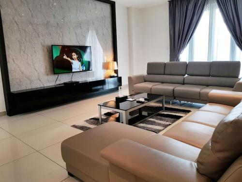 A seating area at KSL Hotel and Resort - Apartment