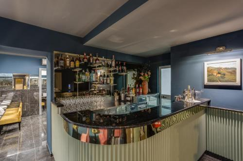 The lounge or bar area at Otivm Hotel