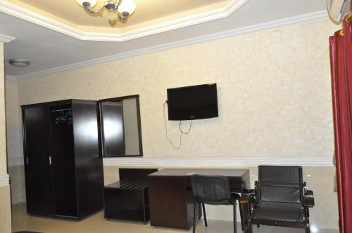 A television and/or entertainment center at Royal Hotel