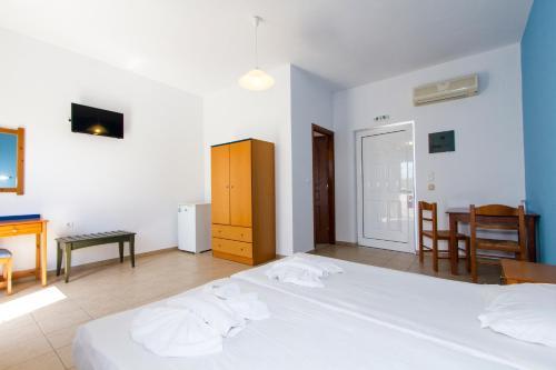 Ένα ή περισσότερα κρεβάτια σε δωμάτιο στο Mediterranean Hotel Studios Apartments