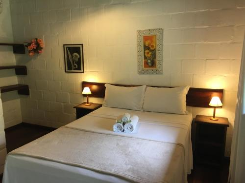 A bed or beds in a room at Hotel Sambaetiba