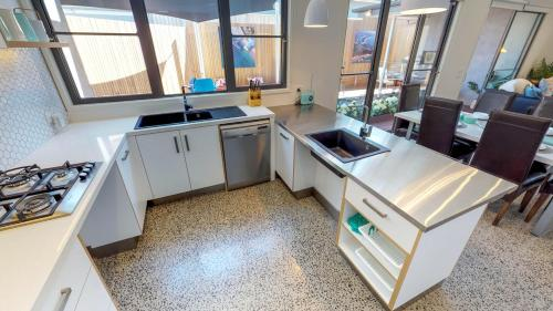 A kitchen or kitchenette at Luxury Accessible Homes