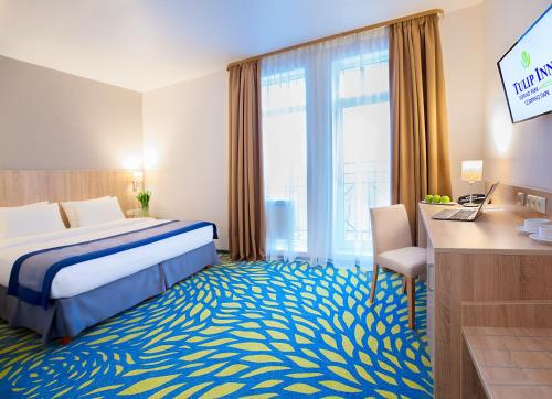 Кровать или кровати в номере Tulip Inn Sofrino Park Hotel