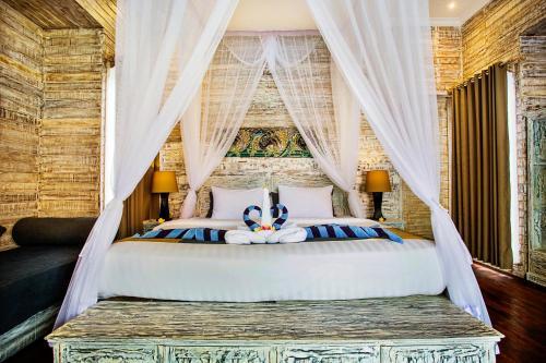 A bed or beds in a room at The Palm Grove Villas
