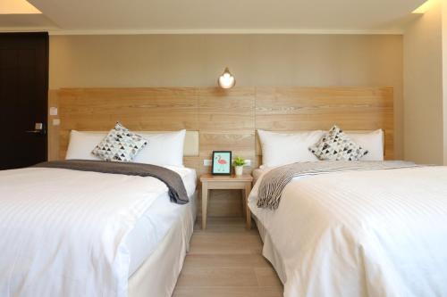 花水木民宿 房間的床