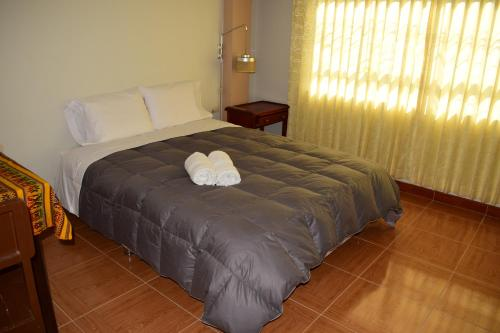 Cama o camas de una habitación en Alojamiento Condor Kanqui