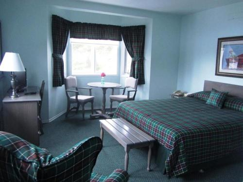 A bed or beds in a room at The Gaultois Inn